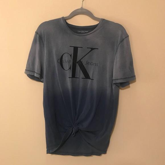 85a2dea345e1 SOLD Vintage Calvin Klein T-shirt. Calvin Klein Jeans.  M_5b5e68a0477368298b10da28. M_5b5e68a2e9ec895f6aefd525.  M_5b5e68a6b6a94236472a31e0